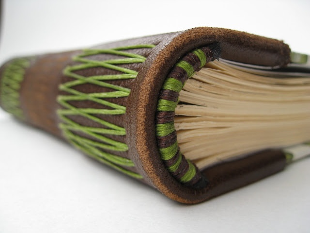 green brown headband on leather spine